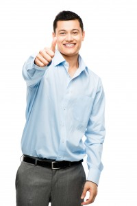 Happy asian businessman thumbs up isolated plain white backgroun